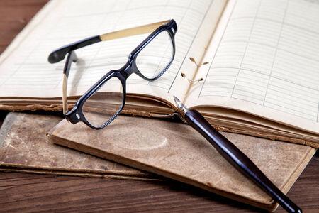 stilllife: Still-life with old writing-books a nib  Stock Photo