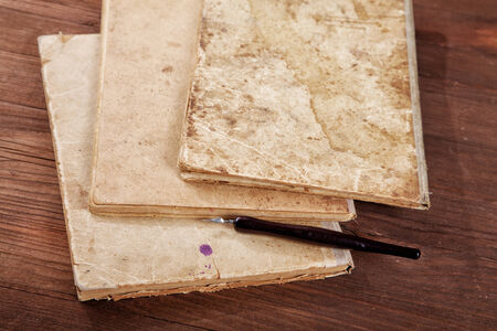 nib: Still-life with old writing-books a nib