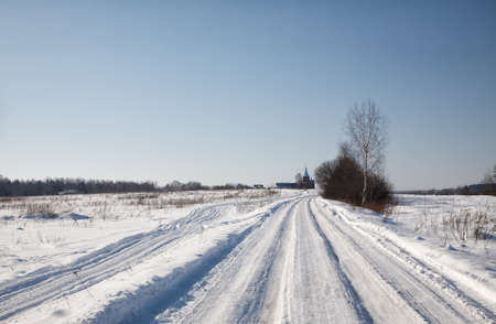orthodox wooden church, a winter landscape photo