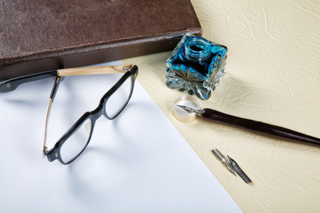 Still-life with the old Ink pot and quill photo