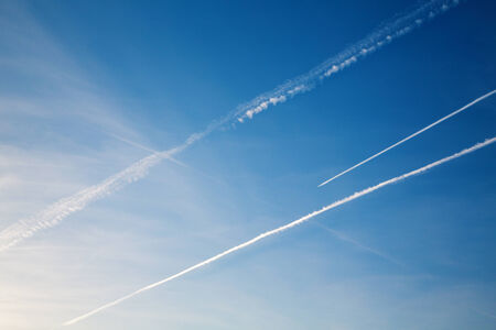 vapor trail: Airplane with trail against the blue sky