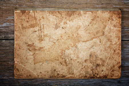 caligraphy: texture of an old writing-book on an old board