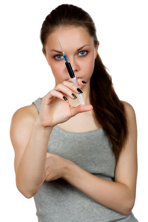 abuser: girl about a syringe in  hand on  white background Stock Photo