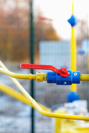Yellow gas pipe with a crane and valve Stock Photo