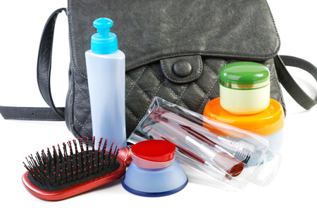 Female bag and cosmetics isolated on a white background photo
