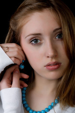 Portrait of the girl with earrings and a beads photo