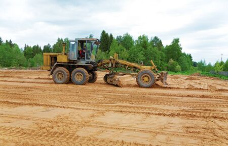 grader: The grader clears away a ground