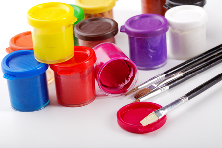 gouache: Jars of gouache and brush for drawing Stock Photo
