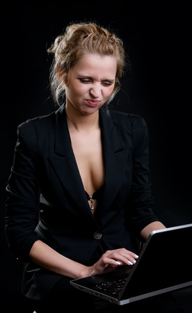 pout: girl with a pout holding a laptop