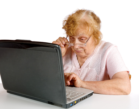 octogenarian: The old woman looks at the screen notebook