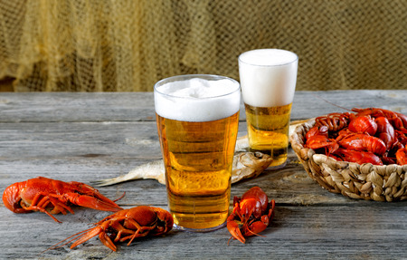 Tasty boiled crayfishes vyaleny fish and beer on old table Stock Photo