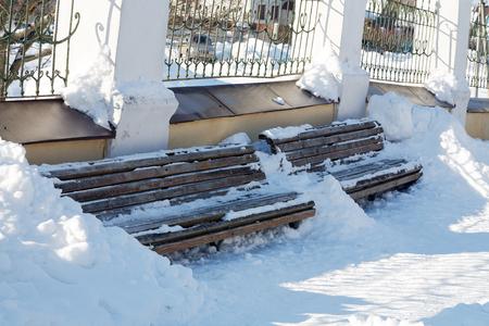 snowdrifts: wooden bench in winter snowdrifts