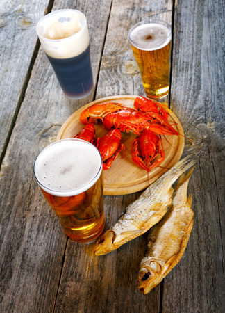crustacea: Tasty boiled crayfishes and beer on old table Stock Photo