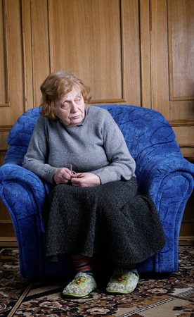 octogenarian: The old woman sits in an armchair