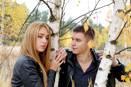 attractive girl: boy and girl at a birch in autumn Stock Photo