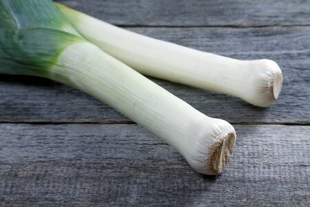 large shallot stalks on a rustic table