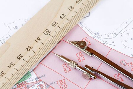 drawing a plan: Topographic map of district with  measuring instrument and ruler Stock Photo