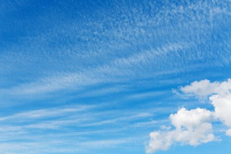 nebulosity: stratocumulus clouds and the dark blue sky Stock Photo