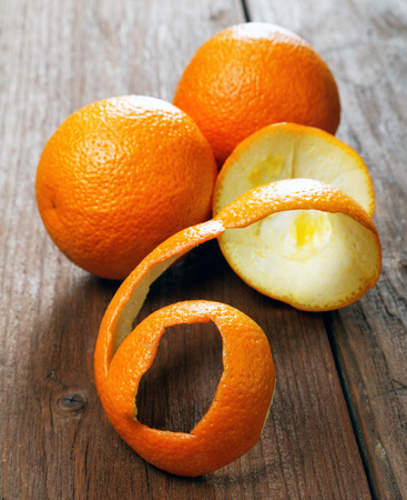 repast: Oranges and dried peel on a rural table