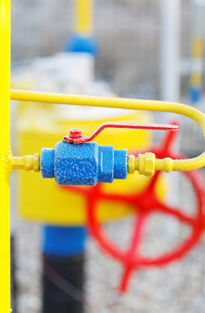 inoperative: Yellow gas pipe with a crane and valve Stock Photo
