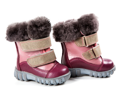 travelled: Childrens winter boots isolated on white background