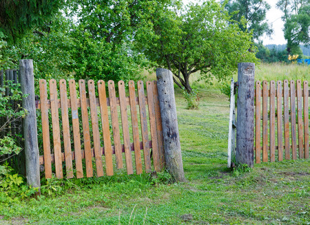 rickety: rickety fence in the countryside a summer day