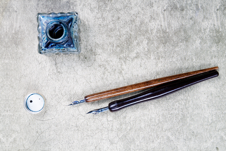 inkstand: vintage fountain pens and ink on a retro background...