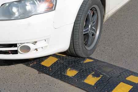 encounters: car tire encounters a sleeping policeman