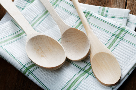 kitchen towel and wooden spoon on the table