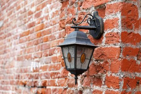 Vintage lantern on old red brick wall Stock Photo