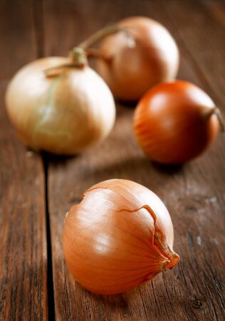 Onions and peel on an old rural table Stock Photo
