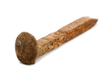 wood railways: Rusty railway bolt isolated on white background
