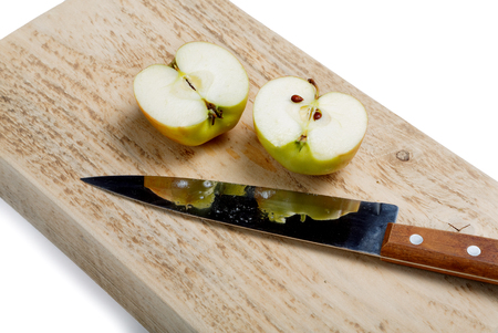 Cut apple with a knife on a white background