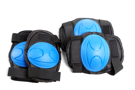Knee pads and elbow pads isolated on white background Stock Photo