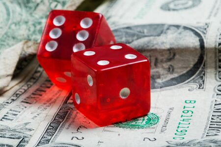 dice and old dollars close-up game of money Stock Photo