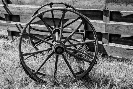 wooden wheels from an old wagon.black and white photography