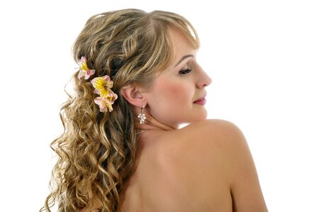 girl with bare shoulders and closed eyes on a white background Stock Photo