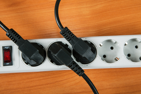 The electric extension piece with wires on table close up Stock Photo