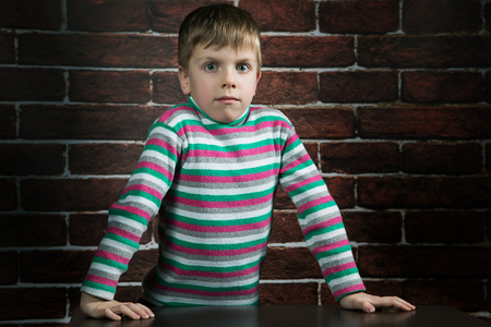 six year old boy with a surprised expression on the wall