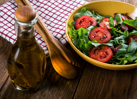 Vegetable salad with tomatoes and arugula on the table Stock Photo