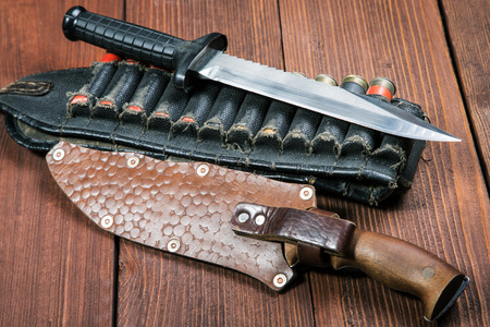 still life with a knife and bandolier on a close-up table Stock Photo