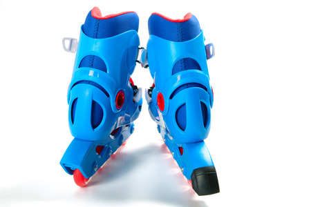 Blue roller skates isolated on white background Фото со стока - 99914989
