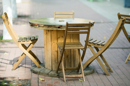 wooden chairs close-up in a street cafe fall