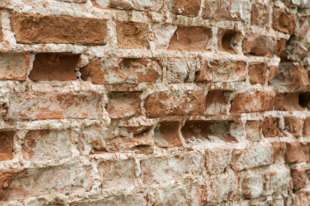 texture of old brick wall with potholes and plaster