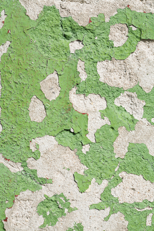 stone texture with pieces of green and gray paint