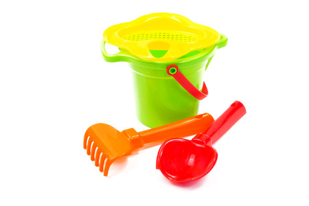 Childrens toys  bucket  shovel and  rake isolated on the white