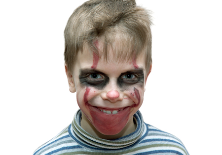 six year old boy in terrifying make up on white background 写真素材
