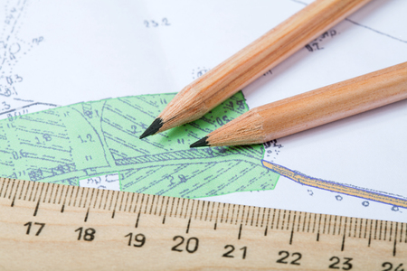 topographic map with pencils lying on it close up 写真素材