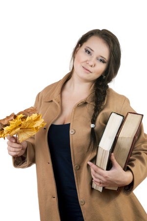 plus size woman with thick volumes of books on a white background 写真素材