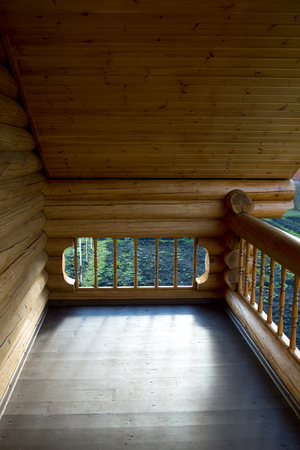 element of the balcony of the house from the Russian house from round logs 写真素材
